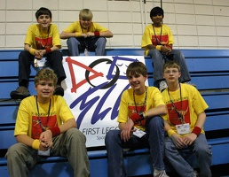 Roboraptors team with FLL sign