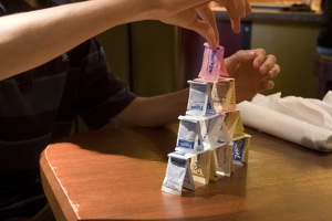 308-6585 Thomas builds a tower with sweetener packets